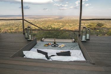 Veranda eines Gästezimmers im Mpingo Ridge